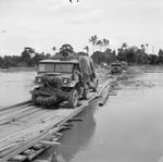 British Army convoy of Canadian Chevrolet CMP 3-ton trucks crossing a temporary bridge in Burma on their way to Rangoon (now Yangon), 26 Apr 1945.