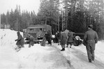 CMP Field Artillery Tractor with gun in tow after suffering a mishap on an icy snow covered road, British Columbia, Canada, 1943-45.