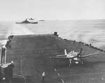 F6F-3 Hellcats of Fighting Squadron 16 (VF-16) landing aboard the USS Lexington (Essex-class), north of Manaus, 28 Apr 1944. Note battleship USS South Dakota crossing Lexington's wake.