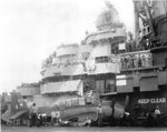 TBM-1C Avenger crash landed aboard USS Hornet (Essex-class) after the landing gear collapsed due to hydraulic failure from battle damage, 15 Jun 1944. Photo 2 of 2.