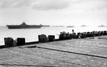 As seen from of the USS Hancock, the USS Lexington and USS Yorktown (both Essex-class) are anchored close aboard at Ulithi, late Dec 1944. Note Hancock's 20mm anti-aircraft guns lining the flight deck.