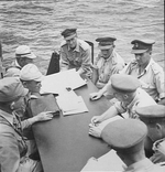 Vice Admiral Michiaki Kamada (far left) surrendering Japanese Naval forces on Borneo to Australian Major General Edward Milford aboard HMAS Burdekon in Makassar Strait, 8 Sep 1945.