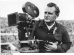 Horst Grund filming the Olympic Games at Helsinki, Finland, Jul-Aug 1952