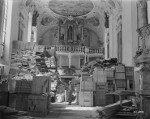 US 3rd Army soldier guarding loot found stored in the Schlosskirche (Castle Church) at the Ellingen Castle in southern Germany, 24 Apr 1945