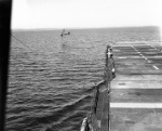 US Navy TDN-1 drone test from the decks of the training carrier USS Sable while steaming in reverse in Grand Traverse Bay, Michigan, United States, 10 Aug 1943. This particular test was unsuccessful. Photo 4 of 4.