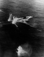 A rocket attack on the German Type VIIC Submarine U-758 by TBF Avengers from USS Block Island northeast of the Azores, 11 Jan 1944. Note two rockets hitting just astern of the U-Boat. U-758 was damaged but not sunk.