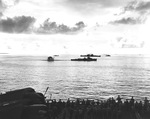 A destroyer escort dropping depth charges on a second Japanese Kaiten in the cruiser anchorage of Ulithi Lagoon on 20 Nov 1944 after the sinking of USS Mississinewa. Seen from USS Bunker Hill. Photo 1 of 3.