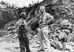 Captain Edward Steichen, head of the Navy's combat photography and Director of the Naval Photographic Institute, right, speaking with US Marine Corporal William Damato on Iwo Jima, Bonin Islands, Mar 1945