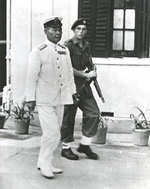 Japanese Navy Vice Admiral Ruitaro Fujita arriving at Government House, Hong Kong, for the surrender ceremonies while escorted by a Royal Marine, 16 Sep 1945. Note Thompson M1A1.