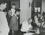 Japanese Navy Vice Admiral Ruitaro Fujita signing the Instrument of Surrender of Japanese forces in and around Hong Kong, Government House, Hong Kong, 16 Sep 1945