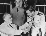 US Navy Lt Commander John D. Bulkeley receives the Medal of Honor from President Franklin Roosevelt, 4 Aug 1942. The medal was for his actions as a PT Boat Squadron commander in the Philippines, Dec 1941-Apr 1942