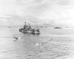Cruiser USS Nashville, General Douglas MacArthur's flagship during the Leyte Gulf operations, at anchor off Leyte, Philippine Islands, about 21 Oct 1944. Note destroyer USS Bush or USS Mullany at right.