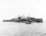 Cruiser USS Houston moored alongside repair ship USS Hector in Ulithi Lagoon, Caroline Islands, 1 Nov 1944. Houston was getting repairs after two torpedo hits on 14 and 16 Oct 1944 off Formosa (Taiwan).