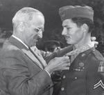 President Truman presenting the Medal of Honor to medical corpsman Desmond Doss at the White House, Washington DC, 12 Oct 1945. The medal was for actions on Okinawa, Japan. Photo 2 of 3.