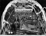 Close-up view of a P-38G Lightning aircraft cockpit, 23 Dec 1942; note the yoke rather than stick control and the bullet proof glass panel above the instrument panel. Photo 2 of 3.