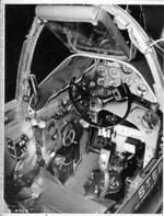 Close-up view of a P-38G Lightning aircraft cockpit, 23 Dec 1942; note the yoke rather than stick control and the bullet proof glass panel above the instrument panel. Photo 3 of 3.