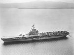 USS Randolph at anchor in Guantanamo Bay, Cuba, fall 1953. Note that the twin 5-inch gun turrets have been removed from the flight deck and also note F9F Cougar jet aircraft forward with wings folded.