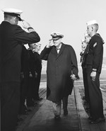 Sir Winston Churchill receiving honors aboard the USS Randolph at Cannes, France, 26 Oct 1958. This was Churchill's first visit to a warship since World War II.