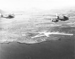 Three PBY-5A Catalinas of Patrol Squadron VP-73 approaching Reykjav�k, Iceland, 23 Mar 1942. Note the red and white rudder stripes that were authorized for barely four months.