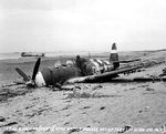2 Jul 1944 photo of the wreckage left on Sword Beach following the D-Day landings in Normandy, France; in this case, a P-47 Thunderbolt that was shot down 10 Jun 1944 on a mission to Cherbourg, France. Photo 1 of 2.