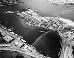 Aerial view of the Pearl Harbor Submarine Base with the supply depot on the Kuahua Peninsula in upper center, 13 Oct 1941. Note the building in the lower left with a roof painted to resemble two smaller buildings.