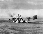 Battleship USS Mississippi bombarding Luzon, Philippines, 8 Jan 1945, during the Lingayen Gulf operation. Battleship USS West Virginia and cruiser HMAS Shropshire are behind Mississippi.