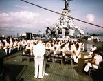 Navy Chaplain Lt Rival Hawkins conducting Sunday services on the USS Missouri's fantail during the ship's shakedown cruise in the Trinidad area, Aug 1944. The censored ship at right is the USS Alaska.