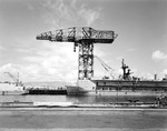The 200-ton Hammerhead Crane fixed to Berth B-12 at the Repair Basins of the Naval Operating Base at Pearl Harbor, Hawaii, 5 Jan 1978. This crane was in use from 1935 and removed in 1986.