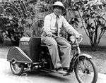 "US Navy photographer Tai Sing Loo was well known around the Navy yard with his trademark pith helmet and his bright red, gasoline powered, three-wheeled ""putt-putt"", Pearl Harbor, Hawaii, 1940s."