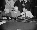 Morris Sheppard, George Lynch, and A. B. Chandler inspecting Johnson M1941 rifles, Washington, DC, United States, 29 May 1940