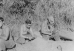 Men of US 5332nd Brigade (Provisional) decoding intercepted Japanese messages, Burma, 1945; Sindelar, Thompson, and Dennis Collins
