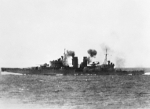 HMS Exeter firing on Japanese aircraft, Java Sea, 15 Feb 1942; photograph taken from HMAS Hobart