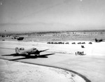 One C-47 Skytrain tow plane on the taxiway at a glider training airstrip in Texas and one CG-4A glider on the ramp, 1943.