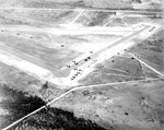 Aerial view of a glider training airstrip in Texas, 1943. Visible are C-47 Skytrain tow planes with Waco CG-4A gliders. Photo 3 of 5