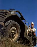 US Soldier in a Willys MA Jeep, United States, 1941. Note the fender-mounted headlamp of the MA rather than the more familiar behind the grille mount of the MB. Note also the soldier's blue armband from a war game.