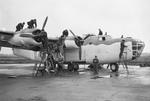 Staged photo of maintenance crews servicing a Liberator III of RAF No 224 Squadron at Beaulieu, Hampshire, United Kingdom, Dec 1942.