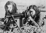 Female Japanese civilians training with a Type 11 machine gun, Ryukyu Islands, Jun 1945