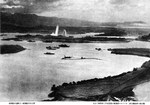 Japanese aerial photo of Pearl Harbor, Hawaii during the attack on 7 Dec 1941. Note torpedo plumes rising from the battleships West Virginia and Oklahoma and smoke rising from the Ford Island seaplane base at right.