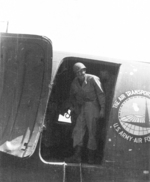 Member of US 5332nd Brigade (Provisional) George Beal entering a C-47 aircraft bound for China, Lashio Airport, Shan, Burma, Apr 1945