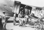 Loading equipment onto a C-47 aircraft, Lashio Airfield, Shan, Burma, Apr 1945; photo taken by personnel of US 5332nd Brigade (Provisional)
