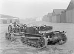 Carden Loyd Mark VI tankette towing a 3.7 inch QF Howitzer Mk I, circa 1929