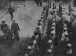 Taiwan Garrison Command Chief of Staff Ke Yuanfen inspecting Japanese internees at the former Taihoku General Government Building, Taipei, Taiwan, Republic of China, 1946, photo 1 of 2