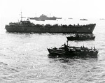 USS Ancon (background), HM LST-404, and other ships off Salerno, Italy, 12 Sep 1943