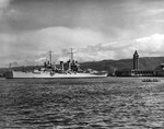 USS Honolulu in Honolulu Harbor, Hawaii, 14 Jul 1939. The Aloha Tower and an outrigger canoe can be seen at right.