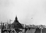 A V-1 buzz bomb falling into the Covent Garden area of London, England, United Kingdom, 14 Jun 1944, the second day of the V-1 assault on London.