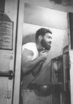 A sailor shaving aboard USS S-44, date unknown