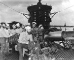 Chief Torpedoman Harold Stromsoe (far left) and others at the deck gun of USS S-44, Jan 1943