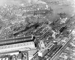 Aerial view of New York Navy Yard, Brooklyn, New York, United States, 15 Apr 1945; note USS Reprisal, USS Coral Sea/Franklin D. Roosevelt, USS Kearsarge, and USS Oriskany under construction