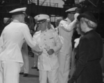 Commissioning ceremony of USS New Jersey, Philadelphia Navy Yard, Pennsylvania, United States, 23 May 1943, photo 07 of 25; note Captain Carl Holden on left