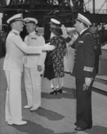 Commissioning ceremony of USS New Jersey, Philadelphia Navy Yard, Pennsylvania, United States, 23 May 1943, photo 09 of 25; note Captain Carl Holden on left